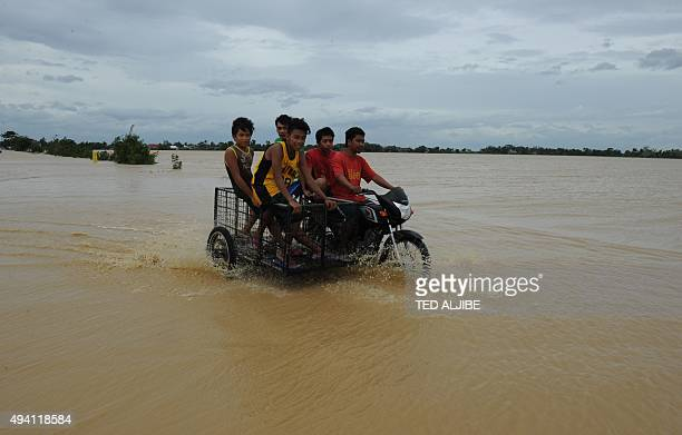 Philippinespovertybankingcreditdisasterfarming FOCUS by Joel Guinto In this photo taken on October 19 2015 shows residents riding on a tricycle...