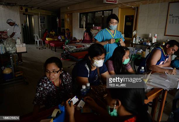 Philippines-weather-typhoon-health-hospital by Cecil MORELLA Medical pesonnel wait for patients at a hospital lobby in Tacloban city, Leyte province,...