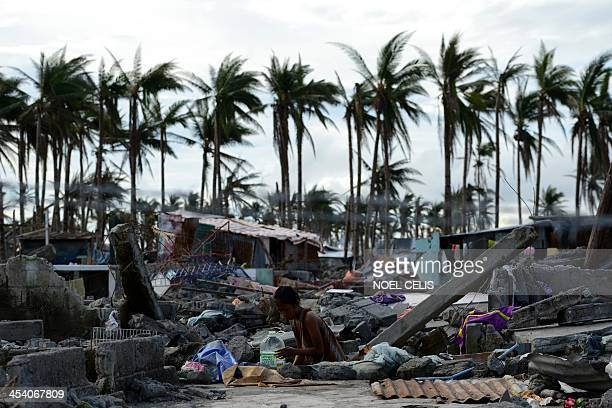 Philippines-weather-typhoon-hope,FOCUS by Karl MALAKUNAS A girl carry water container among debris of destroyed houses in Tacloban, Leyte province on...