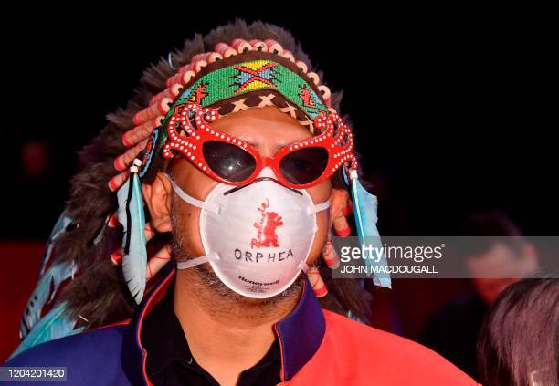 Philippino director Khavn de la Cruz wearing a protection mask poses on the red carpet ahead of the awarding ceremony of the 70th Berlinale film...