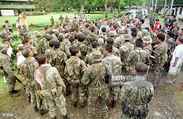 Philippino soldiers listen to Secretary of Defense Angelo T Reyes speak November 25 2001 on the southern isle of Jolo Philippines Fighting broke out...