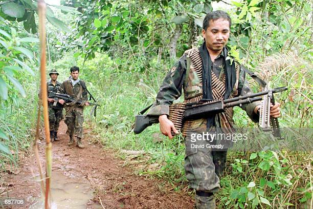 Philippino soldiers return from a patrol to a staging area around two miles away from where it is believed that the Abu Sayyaf Group is hiding...