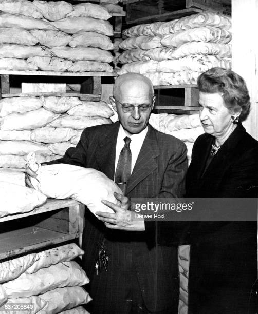 A L Philippus head of the cash and deposits division of the Denver Mint and Mrs Alma K Schneider Mint superintendent display one of the bags of...