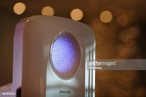 A Philips smart air purifier device manufactured by Royal Philips NV sits on display during the company's annual general meeting in Amsterdam...