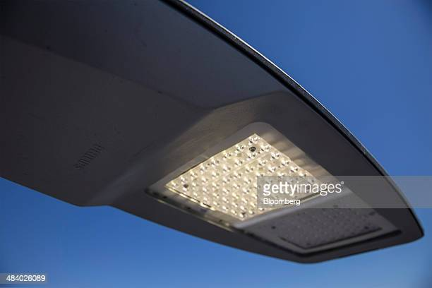 A Philips SpeedStar light emitting diode street light stands illuminated at Royal Philips NV's outdoor lighting application center in Lyon France on...