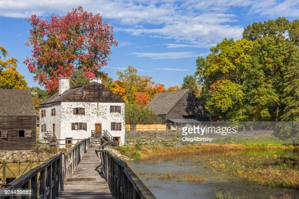philipsburg manor, blue sky and trees in autumn colors (foliage) in sleepy hollow, hudson valley, new york. - westchester county stock photos and pictures