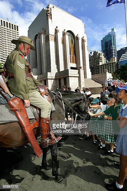 Phill Chalker president of the Australian Light Horse Association and dressed as one of the famed 19141918 Light Horse soldiers watches as...