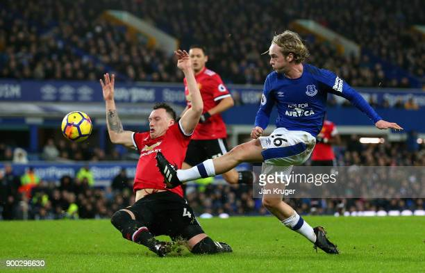 Phill Jones blocks as Tom Davies of Everton crosses during the Premier League match between Everton and Manchester United at Goodison Park on January...