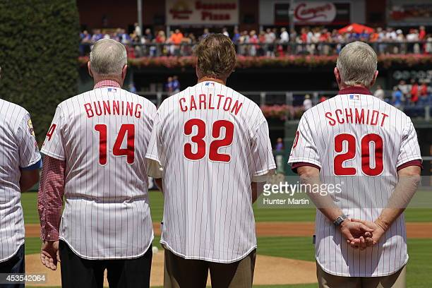 Phillies Alumni and Hall of Famers Jim Bunning Steve Carlton and Mike Schmidt stand on the field during a pre game ceremony before a game between the...