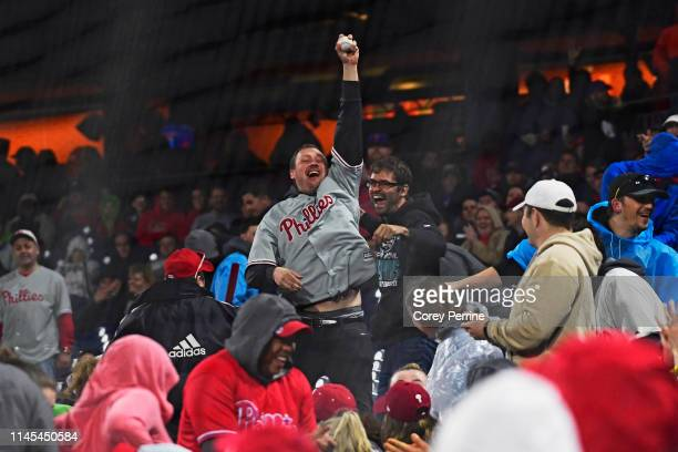 Phillies fan reacts to catching a foul ball during the fifth inning at Citizens Bank Park on April 26, 2019 in Philadelphia, Pennsylvania. The...
