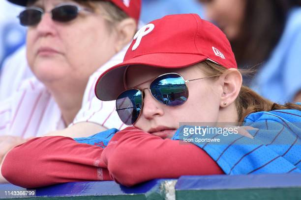 Phillies fan watches her team play during a MLB game between the Philadelphia Phillies and the Kansas City Royals on May 12 at Kauffman Stadium...