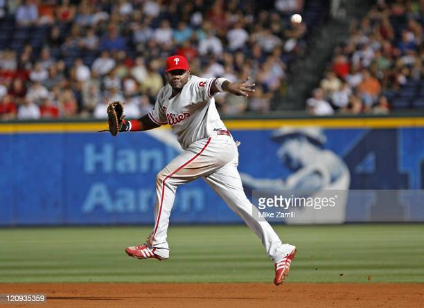 Phillies first baseman Ryan Howard flips the ball to first base during the game between the Atlanta Braves and the Philadelphia Phillies at Turner...