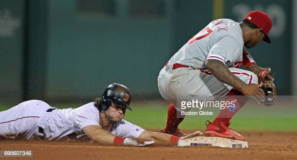 Phillies second baseman Howie Kendrick right takes the throw to double up Red Sox player Andrew Benintendi left and end the inning after Phillies...