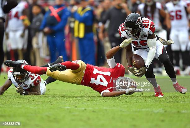 Phillip Adams of the Atlanta Falcons intercepts this pass that was deflected off the hands of Jerome Simpson of the San Francisco 49ers during the...