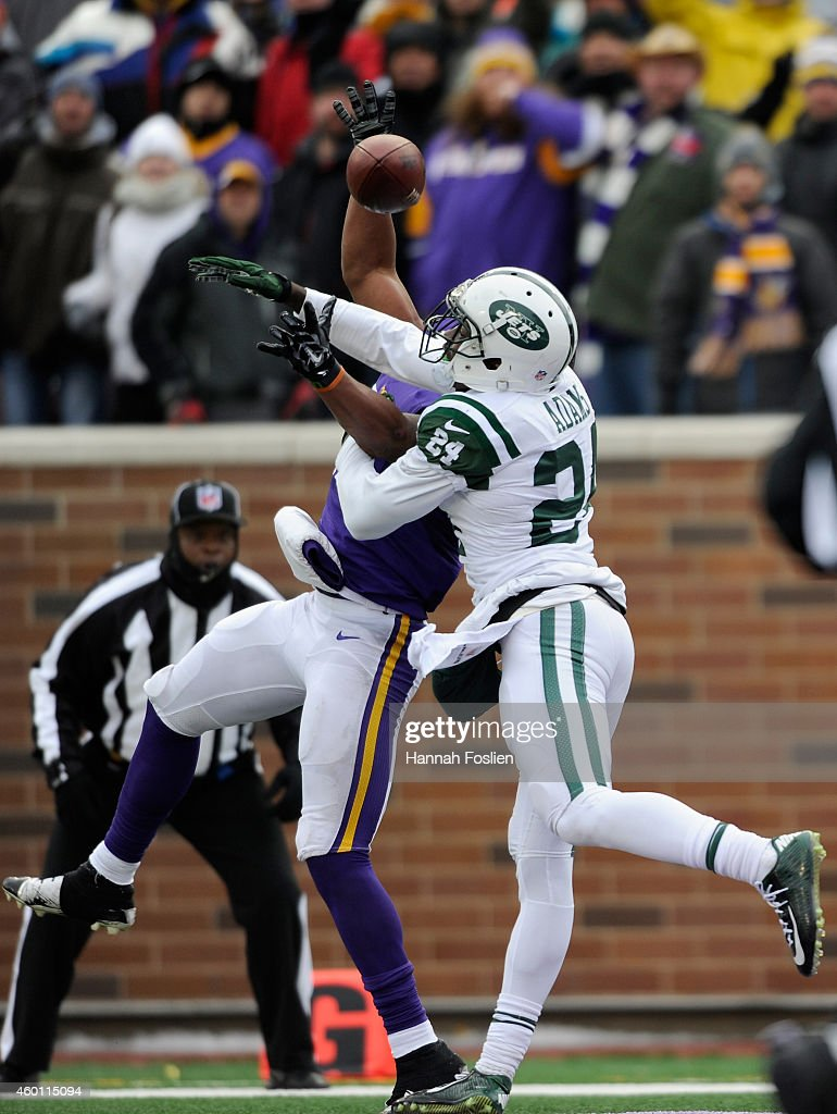 Phillip Adams #24 of the New York Jets breaks up a pass intended for Charles Johnson #12 of the Minnesota Vikings during the fourth quarter of the game on December 7, 2014 at TCF Bank Stadium in Minneapolis, Minnesota. The Vikings defeated the Jets 30-24.
