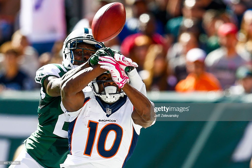 Phillip Adams #24 of the New York Jets breaks up a pass intended to Emmanuel Sanders #10 of the Denver Broncos in the second quarter at MetLife Stadium on October 12, 2014 in East Rutherford, New Jersey.