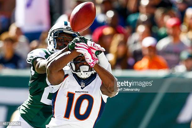 Phillip Adams of the New York Jets breaks up a pass intended to Emmanuel Sanders of the Denver Broncos in the second quarter at MetLife Stadium on...
