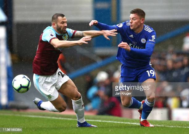 Phillip Bardsley of Burnley battles for possession with Harvey Barnes of Leicester City during the Premier League match between Burnley FC and...