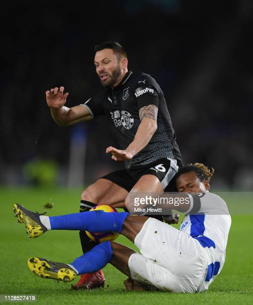 Phillip Bardsley of Burnley collides with Gaetan Bong of Brighton Hove Albion during the Premier League match between Brighton Hove Albion and...
