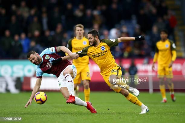 Phillip Bardsley of Burnley is challenged by Florin Andone of Brighton and Hove Albion during the Premier League match between Burnley FC and...