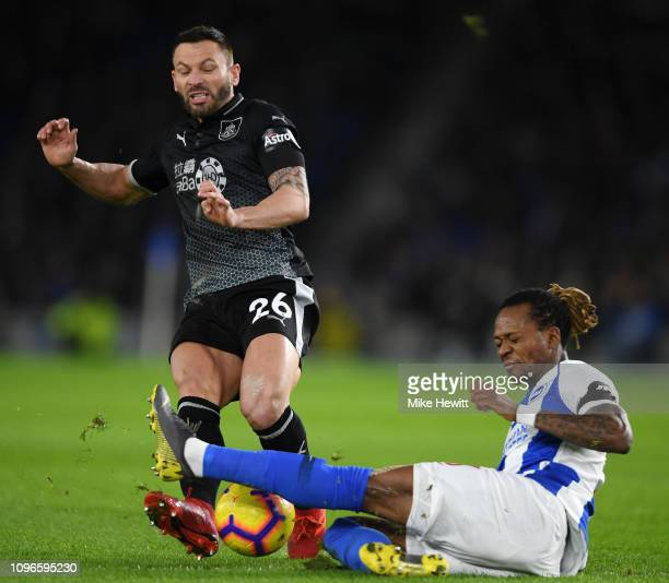 Phillip Bardsley of Burnley is tackled by Gaetan Bong of Brighton and Hove Albion during the Premier League match between Brighton Hove Albion and...