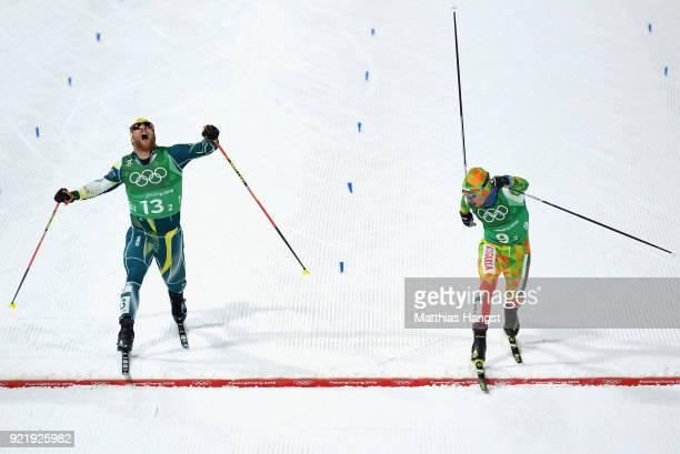 Phillip Bellingham of Australia and Veselin Tsinzov of Bulgaria stretch for the finish line during the Cross Country Men's Team Sprint Free semi...