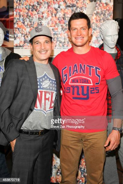 Phillip Bloch and Steve Weatherford attend Junk Food Clothing's 2014 NFL Playoff Tailgate Party at Bloomingdale's on December 5 2013 in New York City
