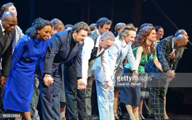 Phillip Browne Alexandra Burke Michael Ball conductor John Rigby Tim Howar Cassidy Janson and Cedric Neal bow at the curtain call during the press...