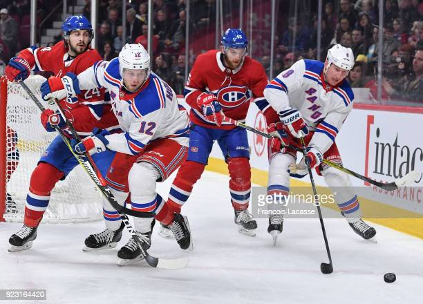 Phillip Danault and Joe Morrow of the Montreal Canadiens defend against Peter Holland Cody McLeod of the New York Rangers in the NHL game at the Bell...