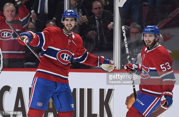 Phillip Danault and Victor Mete of the Montreal Canadiens celebrate a goal against the Winnipeg Jets in the NHL game at the Bell Centre on February...