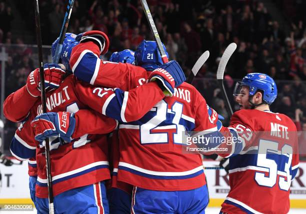 Phillip Danault Max Pacioretty and Victor Mete of the Montreal Canadiens celebrate a goal against the Boston Bruins in the NHL game at the Bell...
