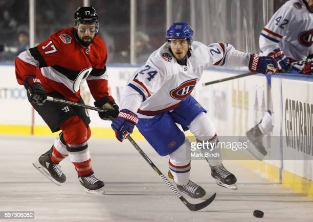 Phillip Danault of the Montreal Canadiens and Nate Thompson of the Ottawa Senators race for the loose puck during the 2017 Scotiabank NHL 100 Classic...