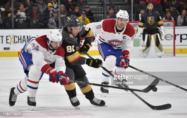 Phillip Danault of the Montreal Canadiens battles Jonathan Marchessault of the Vegas Golden Knights during the third period at T-Mobile Arena on...