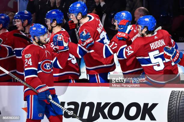 Phillip Danault of the Montreal Canadiens celebrates a third period goal with teammates on the bench against the New York Rangers during the NHL game...