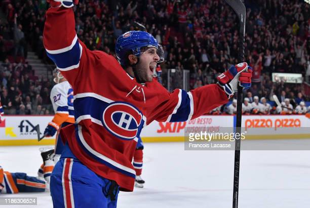 Phillip Danault of the Montreal Canadiens celebrates after scoring a goal against the New York Islanders in the NHL game at the Bell Centre on...