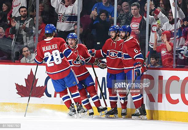 Phillip Danault of the Montreal Canadiens celebrates after scoring a goal against the New York Rangers in the NHL game at the Bell Centre on March 26...