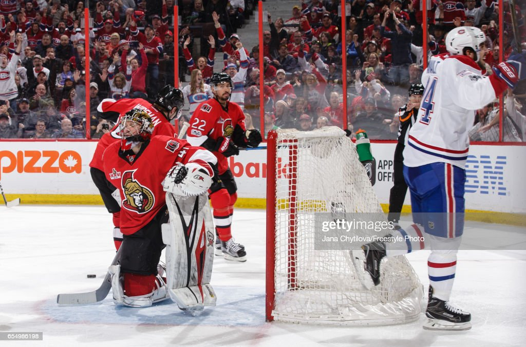 Phillip Danault #24 of the Montreal Canadiens celebrates his third period goal as Chris Kelly #22and Craig Anderson #41 of the Ottawa Senators react at Canadian Tire Centre on March 18, 2017 in Ottawa, Ontario, Canada.
