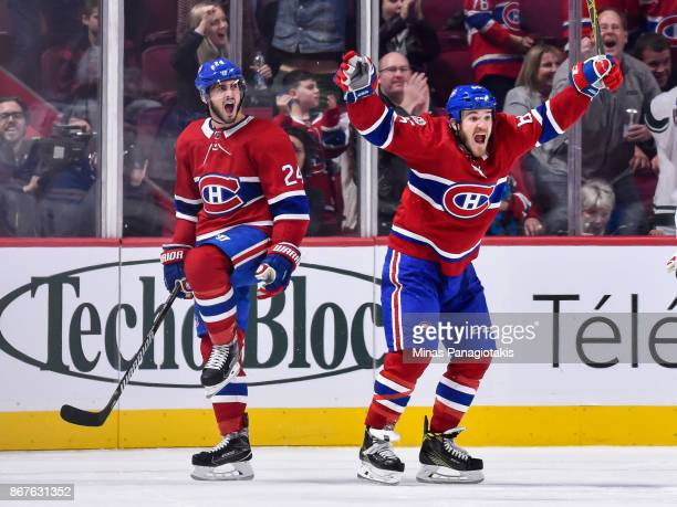 Phillip Danault of the Montreal Canadiens celebrates his third period goal with teammate Andrew Shaw against the New York Rangers during the NHL game...