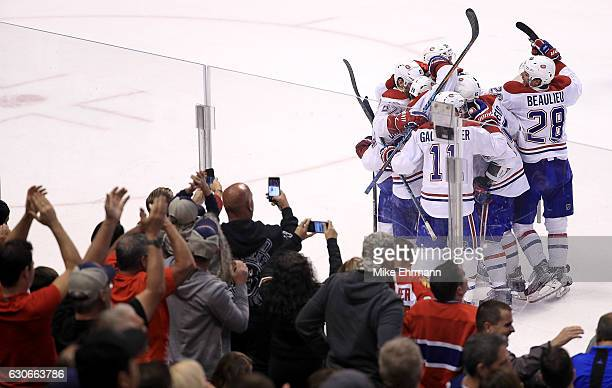 Phillip Danault of the Montreal Canadiens celebrates the game winning goal against James Reimer of the Florida Panthers during a game at BBT Center...