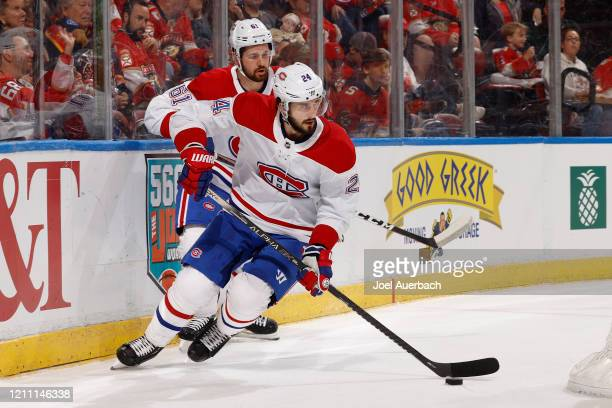 Phillip Danault of the Montreal Canadiens clears the puck from behind the net against the Florida Panthers at the BB&T Center on March 7, 2020 in...