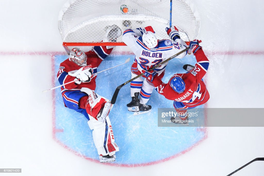 Phillip Danault #24 of the Montreal Canadiens defends against Nick Holden #22 of the New York Rangers as he knocks over goaltender Carey Price #31 in Game Five of the Eastern Conference First Round during the 2017 NHL Stanley Cup Playoffs at the Bell Centre on April 20, 2017 in Montreal, Quebec, Canada. The New York Rangers defeated the Montreal Canadiens 3-2 in overtime.