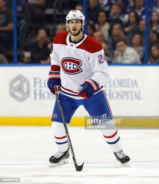 Phillip Danault of the Montreal Canadiens defends against the Tampa Bay Lightning during the first period at Amalie Arena on December 28 2017 in...
