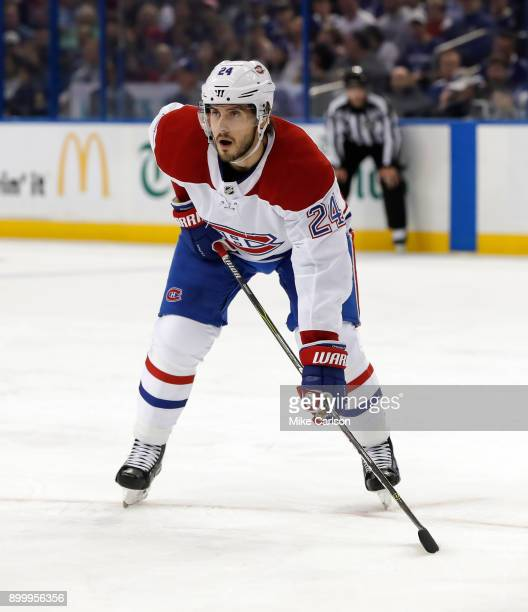 Phillip Danault of the Montreal Canadiens faces off against the Tampa Bay Lightning during the first period at Amalie Arena on December 28 2017 in...