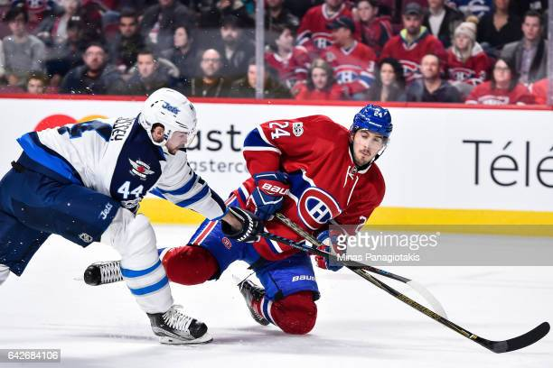 Phillip Danault of the Montreal Canadiens falls in front of Josh Morrissey of the Winnipeg Jets during the NHL game at the Bell Centre on February 18...