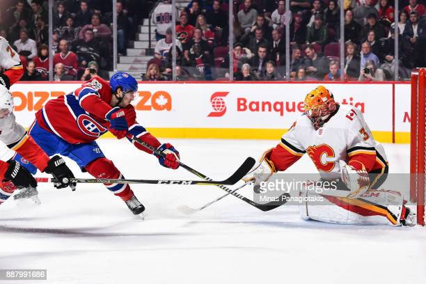 Phillip Danault of the Montreal Canadiens gets a shot on goaltender David Rittich of the Calgary Flames during the NHL game at the Bell Centre on...