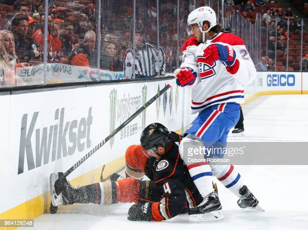 Phillip Danault of the Montreal Canadiens gets his stick stuck in the skate of Cam Fowler of the Anaheim Ducks during the first period of the game at...