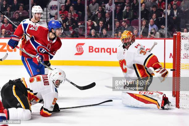 Phillip Danault of the Montreal Canadiens gets the puck past goaltender David Rittich of the Calgary Flames in the second period during the NHL game...