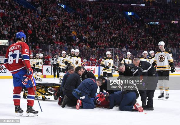 Phillip Danault of the Montreal Canadiens is assisted off the ice after an injury In the second period of NHL game against the Boston Bruins at the...