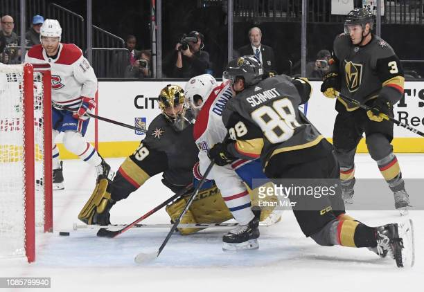 Phillip Danault of the Montreal Canadiens scores his third goal of the game against MarcAndre Fleury and Nate Schmidt of the Vegas Golden Knights to...