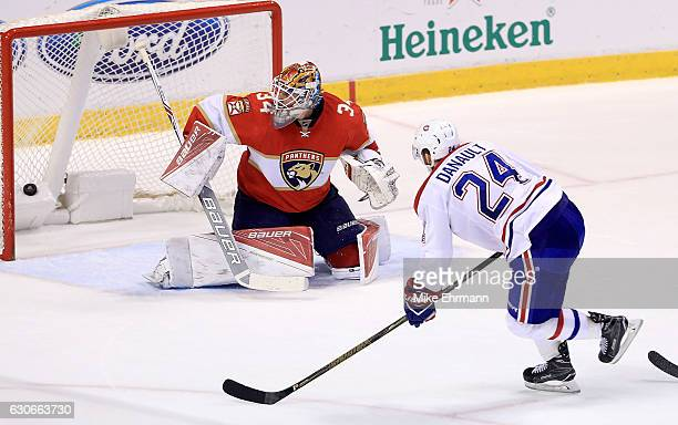 Phillip Danault of the Montreal Canadiens scores the game winning goal against James Reimer of the Florida Panthers during a game at BBT Center on...